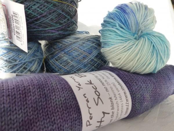 Balls and skeins of sock yarns