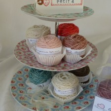 balls of yarns on a cake stand