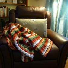 Bright coloured crochet balnket