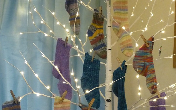 Hand knitted socks on a tree